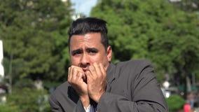 Fearful Hispanic Business Man. A young hispanic adult male stock footage