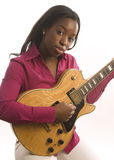 Young hispanic black woman playing electric guitar Royalty Free Stock Photography
