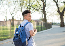 Young Hispanic boy with packpack walk on college campus Stock Photography