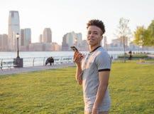 Young hispanic boy on the phone Stock Photo