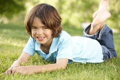Young Hispanic Boy Relaxing In Park Stock Images