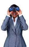 Young Hispanic businesswoman using binoculars Royalty Free Stock Photos