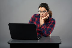 Young hispanic businesswoman working at her laptop Stock Photography