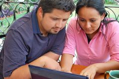 Young Hispanic couple with laptop Stock Photos
