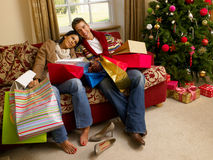 Young Hispanic couple resting. After Christmas shopping Royalty Free Stock Photos