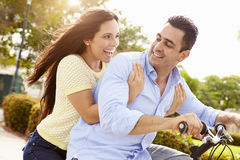 Young Hispanic Couple Riding Bikes In Park Royalty Free Stock Images