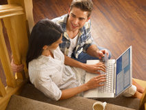 Young Hispanic couple shopping online Royalty Free Stock Image