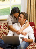Young Hispanic couple shopping online Stock Photography