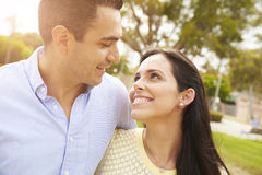 Young Hispanic Couple Walking In Park Together Stock Images