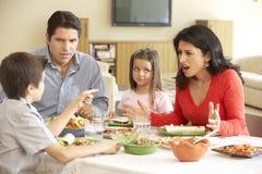 Young Hispanic Family Enjoying Meal At Home Royalty Free Stock Photo