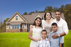 Young Hispanic Family in Front of Their New Home royalty free stock photos