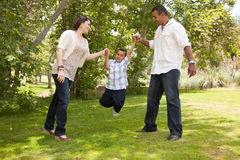 Young Hispanic Family Having Fun in the Park Royalty Free Stock Photography