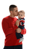Young Hispanic father kissing his son. Isolated on a white background stock photography