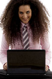 Young hispanic female busy working on laptop Royalty Free Stock Image