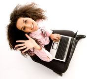 Young hispanic female busy working on laptop Royalty Free Stock Photo
