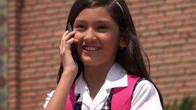 Pretty Girl Making Phone Call. A young hispanic female child Stock Photo