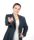 Young Hispanic female handing a set of house keys stock photo