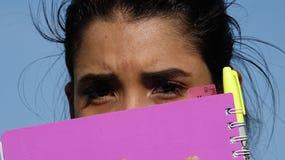 Afraid Fearful Female Student. A young hispanic female teen Stock Photo