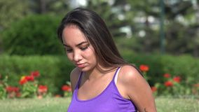 Serious Teen Girl Sitting In Park. A Young Hispanic Female Teen stock video