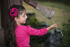 Young Hispanic Girl - Enjoys Rain Stock Photo