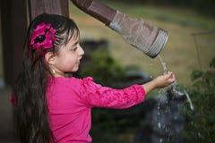 Young Hispanic Girl - Enjoys Rain Stock Photo