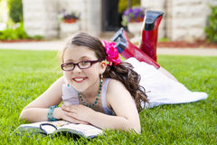 Young Hispanic Girl Reading Outside Smiling Royalty Free Stock Photos