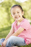 Young Hispanic Girl Relaxing In Park Stock Photos