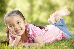 Young Hispanic Girl Relaxing In Park Stock Image