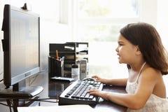 Young Hispanic girl using computer at home Stock Photos