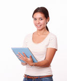 Young hispanic girl working on her tablet pc Stock Images