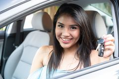 Young hispanic teenage girl learning to drive stock photography