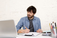 Young hispanic hipster businessman working at computer home office Stock Images