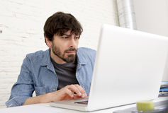 Young hispanic hipster businessman working at computer home office Stock Photos