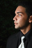 A young hispanic male. Looking to the side Royalty Free Stock Image