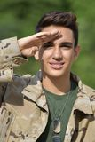 Diverse Male Soldier Saluting. A young hispanic male teen Royalty Free Stock Photos