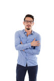 Young hispanic man with blue shirt and glasses Stock Photo