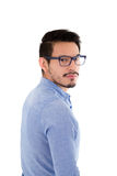 Young hispanic man with blue shirt and glasses Royalty Free Stock Images