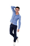 Young hispanic man with blue shirt touching his Royalty Free Stock Photography