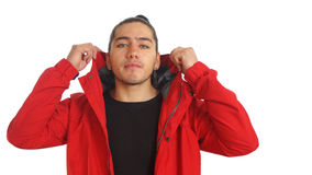 Young hispanic man with gathered hair done bow wearing black t-shirt and red jacket, posing in front Royalty Free Stock Photos
