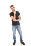 Young hispanic man posing with crossed arms. Handsome young man posing holding chin isolated on white Royalty Free Stock Image