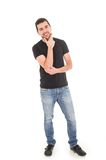 Young hispanic man posing with crossed arms. Handsome young man posing holding chin isolated on white Royalty Free Stock Photos