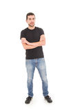 Young hispanic man posing with crossed arms Stock Photography