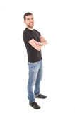 Young hispanic man posing with crossed arms. Isolated on white Stock Photography