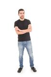 Young hispanic man posing with crossed arms. Isolated on white Stock Photos