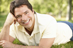 Young Hispanic Man Relaxing In Park royalty free stock image