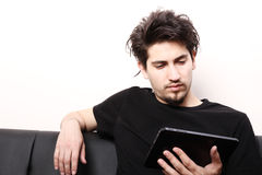 Young man with aTablet PC Royalty Free Stock Images