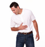 Young hispanic man with stomach pain Royalty Free Stock Photos
