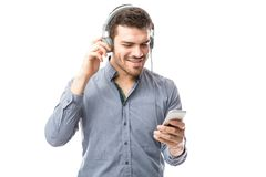 Hispanic man streaming music. Young Hispanic man streaming some music over the internet using a smartphone Stock Images