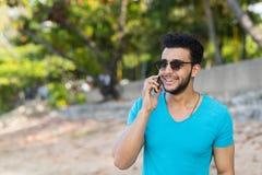 Young Hispanic Man Talking Phone Call Tropical Beach Sea Holiday Guy Summer Vacation Stock Photo