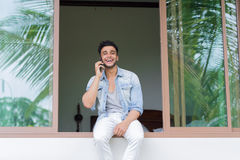 Young Hispanic Man Talking Phone Call Tropical Forest Hotel Terrace Holiday Guy Summer Vacation. Travel Stock Photos